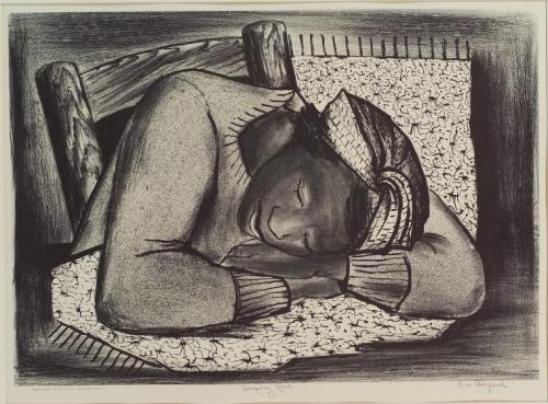 Jeune femme dormant sur son bureau